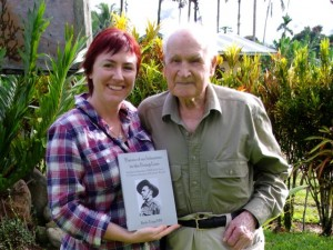Kerrie Phipps and Bede Tongs in Kokoda with Bede's book.